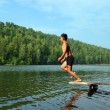 Boy jumping in lake — Stock Photo