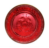 Glass with red aerated water — Stock Photo