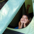 Smiling boy looking from tent — Stock Photo