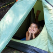 Stock Photo: Smiling boy looking from tent
