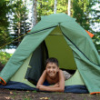 Happy boy in camping tent — Stock Photo