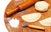 Rolling-pin with patty and pastry — Stock Photo