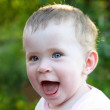 Happy laughing baby outdoor — Stock Photo