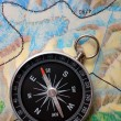 Stock Photo: Compass on geography map