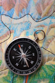 Compass on geography map — Stock Photo