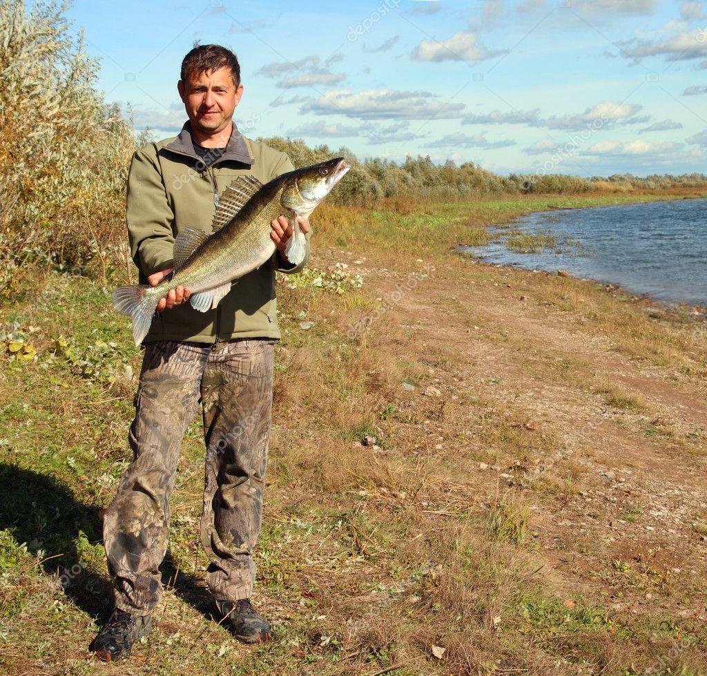 Fishing man with big zander fish stock photo for Big fish script