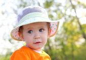 Baby in hat outdoor — Stock Photo