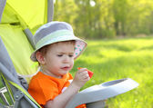 Baby eating outdoor — Stock Photo