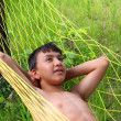 Boy relaxing in hammock — Stock Photo