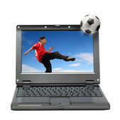 Laptop with boy playing football — Stock Photo