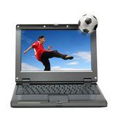 Laptop com menino jogando futebol — Fotografia Stock