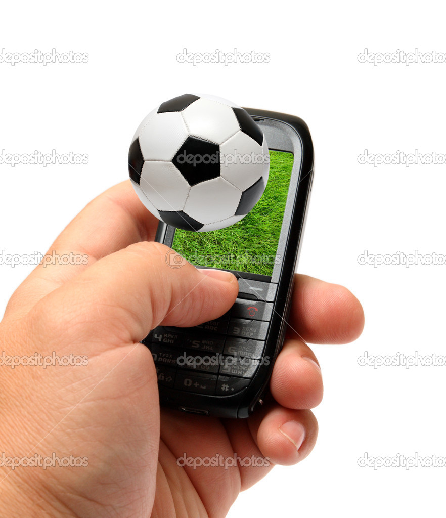 Mobile phone in man hand with football soccer theme — Stock Photo #3406582