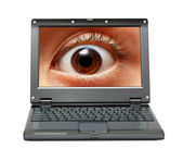 Small laptop with eye on screen — Stock Photo