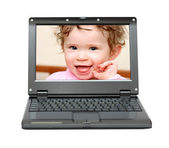 Small laptop with baby — Stockfoto