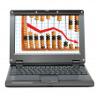 Laptop with decrease diagram and abacus — Stock Photo