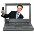 Laptop with businessman giving your phone — Stock Photo