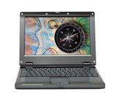 Small laptop with compass and map — Stock Photo