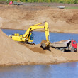 Sandpit - excavator and tipper — Stock Photo