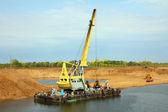 Development sandpit with dredge — Stock Photo