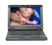 Laptop with bathing baby — Stock Photo