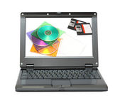 Small laptop with discs and diskettes — Stock Photo