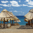 Summer beach with chairs and umbrellas — Stock Photo #3552470