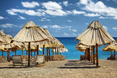 Summer beach with chairs and umbrellas in Montenegro — Stock Photo