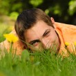 Man lie on the grass - Stock Photo