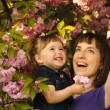 Stock Photo: Mother and daughter in garden