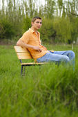 Man on bench — Stock Photo