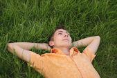Man lie on the grass — Stock Photo