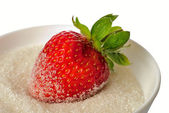 Strawberry in bowl with sugar isolated — Stock Photo