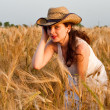 Girl in wheat field - Stock Photo