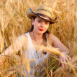 Girl in wheat field — Stock Photo #3319757