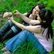Two sisters sitting on grass — Stock Photo #3383537