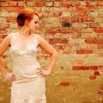 Bride near the brick wall — Stock Photo #3622138