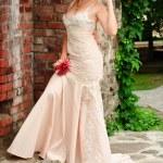 Bride near the brick wall — Stock Photo #3622142