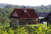 Old village house in sunny day — Stock Photo