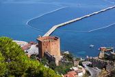 Port Alanya and red brick tower — Stock Photo