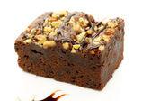 Cake truffle with black chocolate sauce — Stock Photo