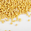 Mustard seeds isolated on white — Stock Photo