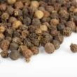 Stock Photo: Detail shot of pile of black peppercorns. All isolated