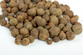 Detail shot of a pile of black peppercorns. All isolated — Stock Photo