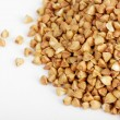 Stock Photo: Buckwheat seeds closeup isolated on white