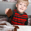 Boy with cookies in hand — Stock Photo