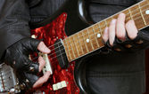 Hands rock musician with a guitar — Stock Photo