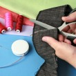 Stock Photo: Cutting fabric