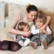 Young mother with her daughter and son — Stock Photo