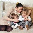 Young mother with her daughter and son — Stock Photo #2771103