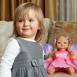 Cute little girl and a doll — Stock Photo